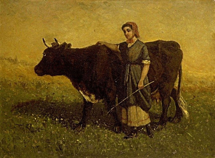 woman walking with cow